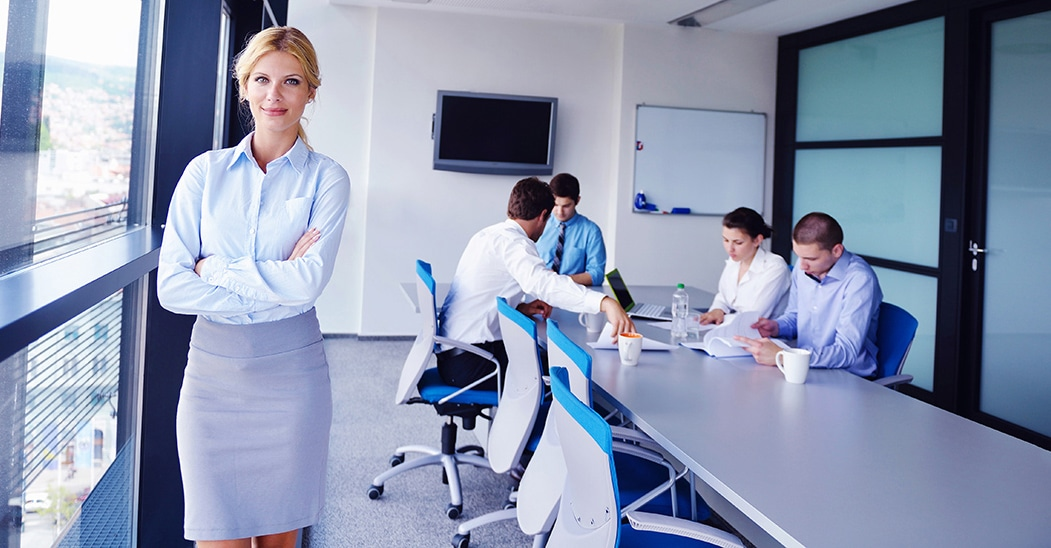 bigstock-business-woman-with-her-staff-389080871.jpg